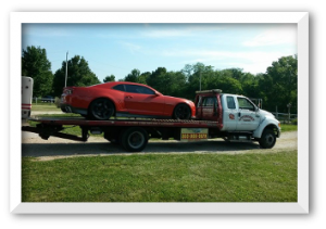 affordable-towing-flatbed-with-car